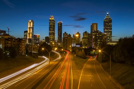 The Atlanta skyline at dusk with light trails