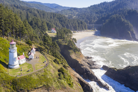 Heceta Head Light is a lighthouse on the Oregon Coast 13 miles (21 km) north of Florence, and 13 miles (21 km) south of Yachats in the United States.