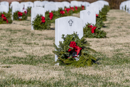 Veterans cemetery adorned with wreaths for the holiday season Editorial