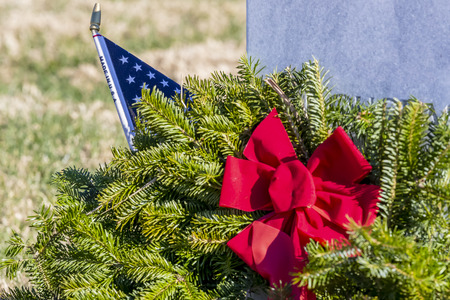 Veterans cemetery adorned with wreaths for the holiday season Stock Photo - 113621154