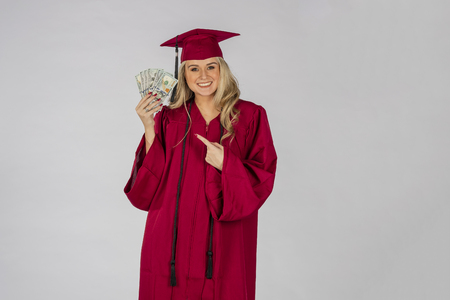 A gorgeous blonde model posing with money after graduation