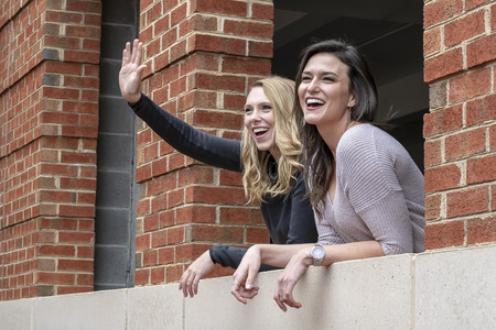 Two gorgeous models enjoying each others company on a fall day Stock Photo