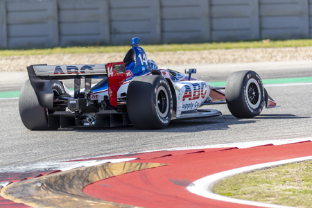 TONY KANAAN (14) of Brazil goes through the turns during practice for the IndyCar Spring Test at Circuit Of The Americas in Austin, Texas.