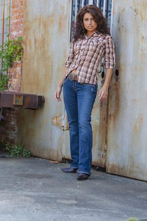 A beautiful Brunette model posing outdoors in an urban environment 版權商用圖片