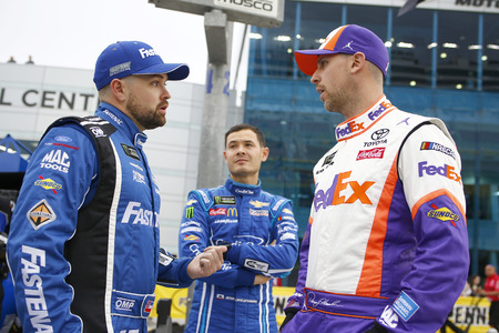 March 01, 2019 - Las Vegas, Nevada, USA: Kyle Larson (42), Ricky Stenhouse, Jr (17) and Denny Hamlin (11) chat before qualifying for the Pennzoil 400 at Las Vegas Motor Speedway in Las Vegas, Nevada.