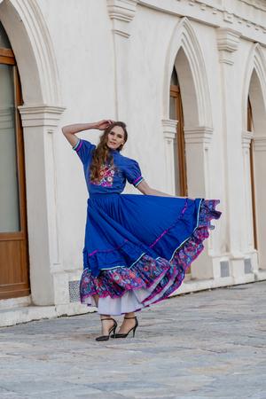 A gorgeous Hispanic Brunette model poses outdoors at a Mexican hacienda Фото со стока