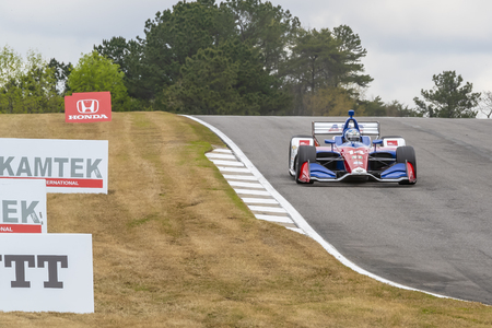 TONY KANAAN (14) of Brazil goes through the turns during practice for the Honda Indy Grand Prix of Alabama at Barber Motorsports Park in Birmingham, Alabama.