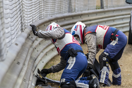 April 06, 2019 - Birmingham, Alabama, USA: The AMR Safety Crew work on the accident site by MARCUS ERICSSON (R) (7) of Sweden  as he brings out a caution  during practice for the Honda Indy Grand Prix of Alabama at Barber Motorsports Park in Birmingham, A Editorial