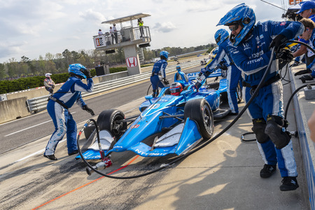 April 07, 2019 - Birmingham, Alabama, USA: FELIX ROSENQVIST (R) (10) of Sweden brings his car in for service during the Honda Indy Grand Prix of Alabama at Barber Motorsports Park in Birmingham Alabama. Editorial