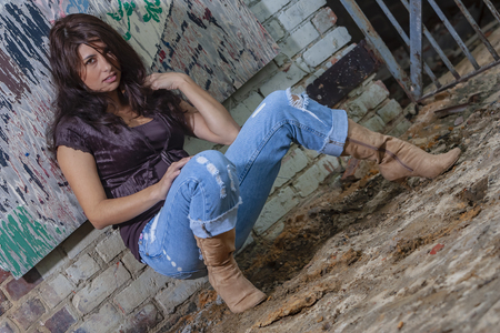 A beautiful Brunette model posing outdoors in an urban environment 版權商用圖片