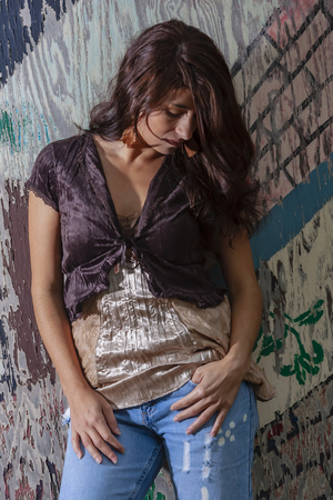 A beautiful Brunette model posing outdoors in an urban environment Stock Photo