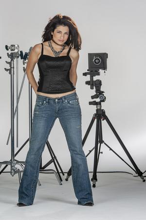 A beautiful brunette model posing in a studio environment Banco de Imagens