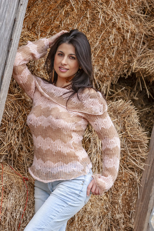 A beautiful Brunette model posing outdoors in an urban environment Banco de Imagens