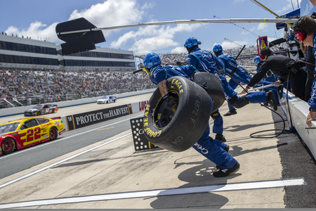 Kyle Larson (42) and crew make a pit stop for the Gander RV 400 at Dover International Speedway in Dover, Delaware.