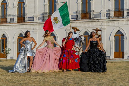 A group of gorgeous Hispanic Brunette models pose outdoors at a Hacienda in Mexico