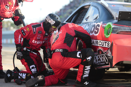 June 10, 2019 - Brooklyn, Michigan, USA: Erik Jones (20) makes a pit stop during the FireKeepers Casino 400 at Michigan International Speedway in Brooklyn, Michigan. Editorial