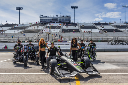 August 24, 2019 - Madison, Illinois, USA: FELIX ROSENQVIST (10) of Varnamo, Sweden  poses with his #10 Monster Enegery IndyCar along with motorcycles from Unknown Indsttries and Monster Enegery models before the Bommarito Automotive Group 500 in Madison,