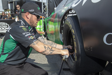 October 26, 2019 - Martinsville, Virginia, USA: Kyle Larson (42) crew challenge fans to tire changes  for the First Data 500 at Martinsville Speedway in Martinsville, Virginia.