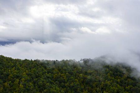 Mountain range during a rain storm in a rural environment