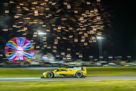 The JDC-Miller Motorsports Cadillac DPi car race through the night during the Rolex 24 At Daytona at Daytona International Speedway in Daytona Beach, Florida.
