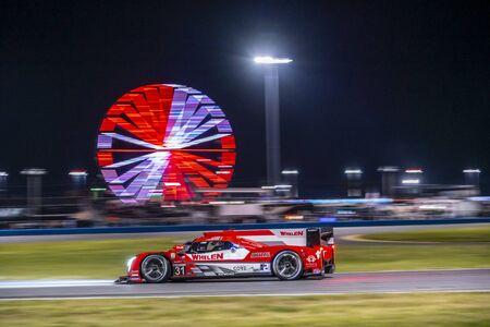 The Whelen Engineering Racing Cadillac DPI car  race through the night during the Rolex 24 At Daytona at Daytona International Speedway in Daytona Beach, Florida.