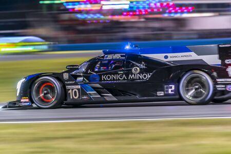 The Konica Minolta Cadillac DPI-V.R. car race through the night during the Rolex 24 At Daytona at Daytona International Speedway in Daytona Beach, Florida.