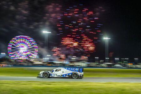 The DragonSpeed USA Oreca LMP2 07 car race through the night during the Rolex 24 At Daytona at Daytona International Speedway in Daytona Beach, Florida.