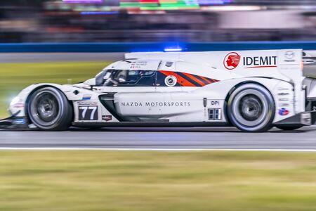 The Mazda Team Joest Mazda DPi car  race through the night during the Rolex 24 At Daytona at Daytona International Speedway in Daytona Beach, Florida. Zdjęcie Seryjne - 139240422