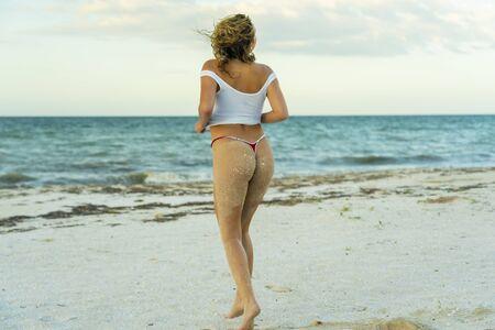 A beautiful blonde bikini model poses at sunset in the Yucatán Peninsula near Merida, Mexico