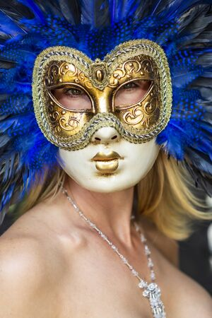 A gorgeous model poses wearing a mask in an indoor environment