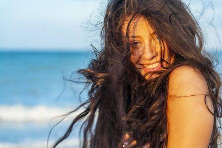 A beautiful brunette model enjoys the sunset in the Yucatán Peninsula near Merida, Mexico
