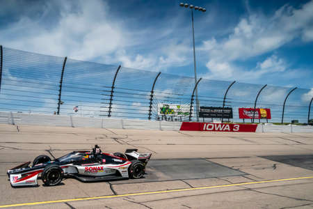 RINUS VEEKAY (R) (21) of Hoofddorp, Netherlands  practices for the Iowa INDYCAR 250s at the Iowa Speedway in Newton, Iowa.