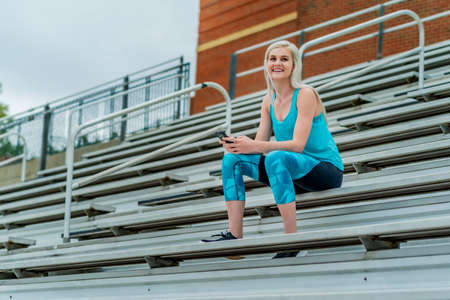 A beautiful young college athlete prepares herself for a track meet at a local university