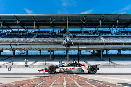 RINUS VEEKAY (R) (21) of Hoofddorp, Netherlands  practices for the Indianapolis 500 at the Indianapolis Motor Speedway in Indianapolis, Indiana.