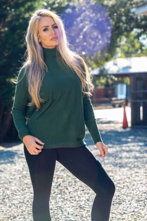 A gorgeous blonde model poses outdoors in her fall clothes Zdjęcie Seryjne