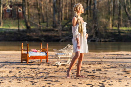 A gorgeous blonde model enjoys a spring day outdoors