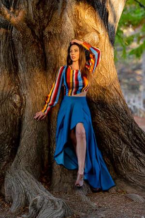 A gorgeous brunette model poses outdoors while enjoying the autumn weather Archivio Fotografico
