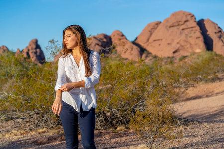 A beautiful hispanic model enjoys the Arizona desert on a winters day