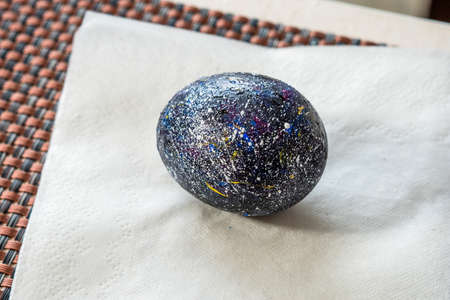 Celebration of Easter. Close-up of colorful painted hard-boiled chicken eggs Standard-Bild