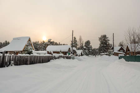 Winter landscape. A snowy Russian village in Siberia. Russia.