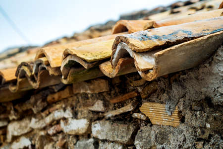 Close-up shot of roof of greek house covered by tiles made of baked clay. Greece