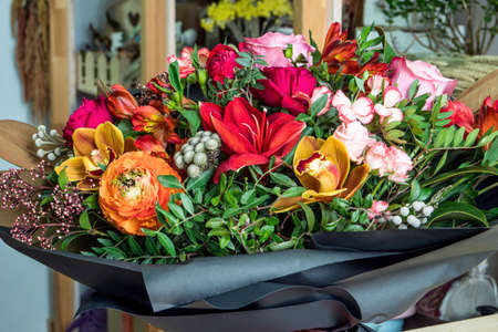 Close-up shot of a beautiful and stylish bouquet of fresh various flowers in floral design studio, flower shop.