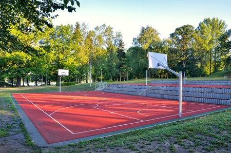 Basketball court over the lake. Place of recreation and leisure.