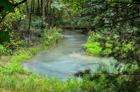 Beautiful blue river. River with beautiful water color in the green forest.