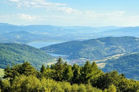 Summer hills landscape. Villages in beautiful mountainous scenery.