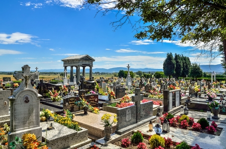WILAMOWICE, POLAND - AUGUST 5, 2017: A cemetery with an ancient tombstone in Wilamowice, Poland. Editorial