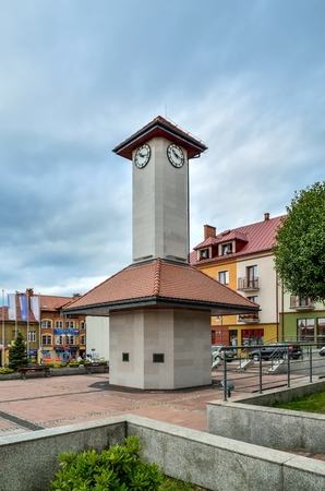 TRZEBINIA, POLAND - AUGUST 19, 2017: Tower with clock and apartment on the market in Trzebinia, Poland.