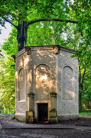 Old antique ice house in the castle park in Pszczyna. Eiskeller Tower in neo roman style in the park in Pszczyna, Poland.