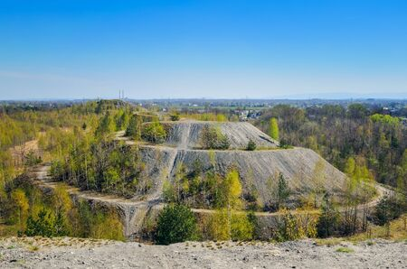 Coal industry in Poland. Mine heap in the spring scenery.