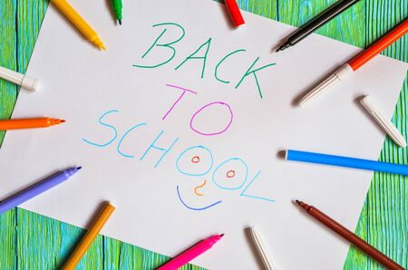 Creative idea depicting the return of children to school. School markers and a card with the text back to school. 스톡 콘텐츠